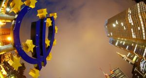 With euro-zone inflation still below its goal of just under 2 per cent, the ECB will continue to buy public and private debt through September 2018. Photograph: Kai Pfaffenbach/Reuters