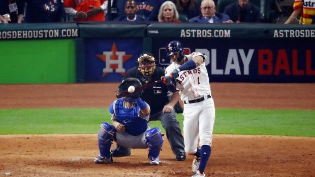 Carlos Correa of the Houston Astros hits a two-run home run during the seventh inning against the LA Dodgers. Photogaph: Ezra Shaw/Getty