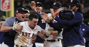 The Houston Astros celebrate after batter Alex Bregman scored the winning run against the LA Dodgers. Photograph: Tannen Maury/EPA