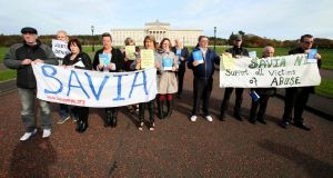Members and supporters of Survivors and Victims of Institutional Abuse  demonstrate against the lack of compensation for victims of institutional abuse, outside Stormont, in Belfast. Photograph: Paul Faith/AFP/Getty Images