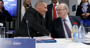 File image of former minister for finance Michael Noonan sitting beside his Greek counterpart, Yanis Varoufakis, at a European Stability Mechanism board of governors meeting. Photograph: Francois Lenoir/Reuters