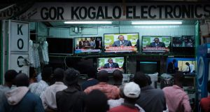 Kenyans watch as Uhuru Kenyatta is declared the winner of the rerun presidential election, at a local electrical shop in Kisumu. Photograph: Yasuyoshi Chiba/AFP/Getty Images