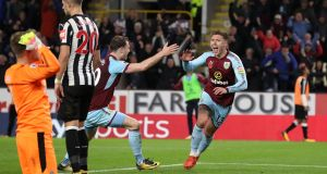 Jeff Hendrick wheels away after scoring Burnley's winner against Newcastle.Photograph: Martin Rickett/PA