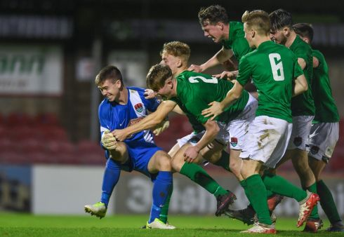 MAN OF THE MOMENT: Cork City players celebrate with their goalkeeper Alan Kelleher after he saved the last penalty during the shootout against Bohemians in the under-17s league final at Turner's Cross. Photograph: Eoin Noonan/Sportsfile
