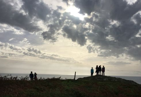 LIKE IT NEVER HAPPENED: Two weeks after Hurricane Ophelia a family walking on bank holiday Monday at Preghane Point near Kinsale, Co Cork, stop to gaze out at calm waters and clear skies. Photograph: Bryan O'Brien/The Irish Times