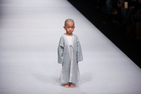 BEIJING FASHION WEEK: Child model presents a creation by Chan Zhe during the Mercedes-Benz China Fashion Week in Beijing. Photograph: Roman Pilipey/EPA