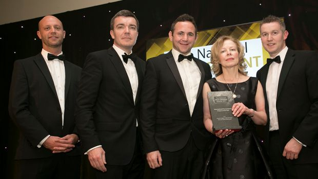 Wayne Dignam, Managing Director, Tender Team presents the International Procurement Project of the Year award to the Exertis Supply Chain Services team