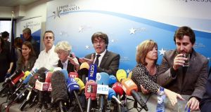 Deposed Catalan regional president Carles Puigdemont (C) gives a statement during a press conference at Press club in Brussels, Belgium. Photograph: Olivier Hoslet/EPA