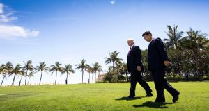 US president Donald Trump walking with President Xi Jinping of China at his Mar-a-Lago resort in Palm Beach, Florida in  April.  Photograph:  Doug Mills/The New York Times