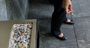 Smokers who are offered cash incentives are far more likely to give up cigarettes than those who are simply offered tips on how to quit, said a US study. Photograph: Chandan KHANNACHANDAN KHANNA/AFP/Getty Images
