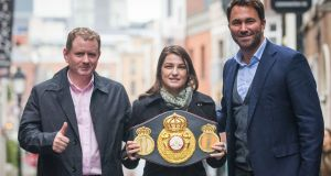 Katie Taylor with manager Brian Peters (L) and promoter Eddie Hearn. Photograph: Oisin Keniry/Inpho