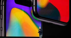 Apple senior vice president of worldwide marketing Phil Schiller introduces the iPhone X during a launch event.