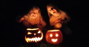 "Jane with ""Frederick"" and Julia's with ""Kuai"". ""Every year Jane and Julia light their pumpkins, dance around them, blow out the candles and make a wish."" - Alan Duffy, Dublin."