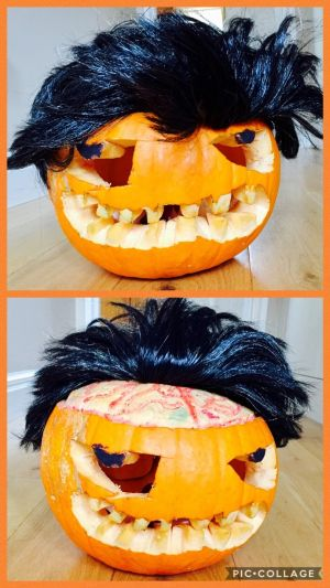 """Trickery Trump"" by Bobby (5), Pia (3) and mum Emer Harrington in Dublin. ""It is our first pumpkin where the kids were able to get involved. Each took turns to draw the eyes, teeth, clear out the goo and paint on the eyes and blood running along the brain. The ""fake"" hair was  an essential finishing touch to our Trumptastic creation!"""