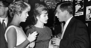Alan Sillitoe, author of 'Saturday Night and Sunday Morning' and actresses in the film of the book, Shirley Anne Field, (centre), and Rachel Roberts at a party in Belgrave Square, London, in August 1960. Photograph: Evening Standard/Getty Images