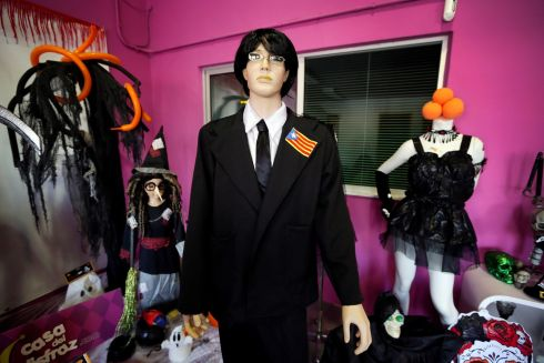 A view of a dummy dressed up as the former Catalan regional government president, Carles Puigdemont in Alicante, Spain. Puigdemont's costume is one of most popular in Spain for this year's Halloween celebrations. Photograph: Manuel Lorenzo/EPA