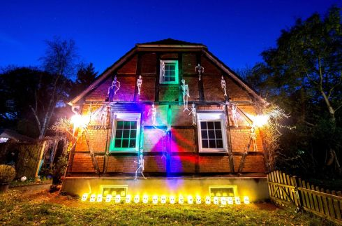A house decorated with fake skeletons in Germany. Photograph: Hauke-Christian Dittrich/AFP/Getty Images