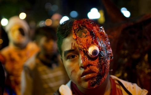 A young man attends a zombie walk in La Paz, Bolivia, in aid of charity. Photograph: Juan Karita/AP