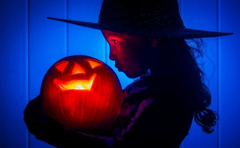 A young girl with a pumpkin as she prepares for Halloween. Photograph: Danny Lawson/PA Wire