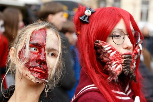 Ukrainians wearing zombie costumes and make-up attend the 'Zombie Walk Kiev/Halloween 2017' parade in Kiev, Ukraine. Photograph: Stepan Franko/EPA