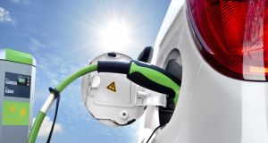 Electric car being charged: just five of the 6,536 vehicles owned by the State are electric-powered. Photograph: Thinkstock