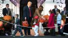US president Donald Trump and first lady Melania Trump hand out Halloween candy to children at the White House in Washington, DC. Photograph: Tom Brenner/The New York Times