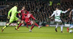 Kingsley Coman of Bayern Munich scores at Celtic Park. Photograph: Steve Welsh/Getty Images