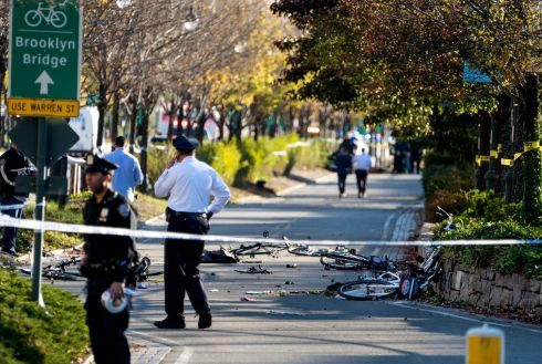 Bicycles and debris lay on a bike path after a motorist drove onto the path near the World Trade Center memorial, striking and killing eight people. Photo: AP/Craig Ruttle