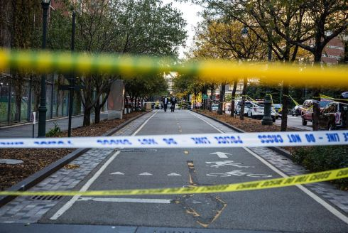 Police tape blocks off a bicycle lane after a motorist attack on the West Side of Manhattan in New York. Photo: Timothy Fadek/Bloomberg