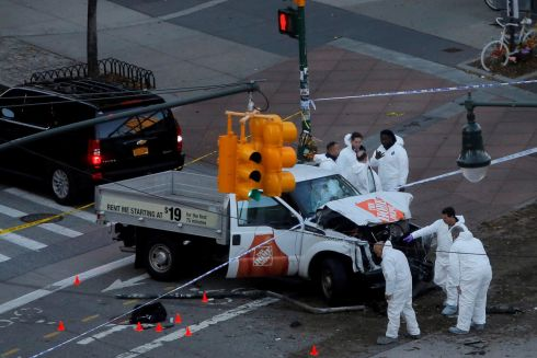 Police investigate the vehicle which rammed cyclists on the West Side Highway in Manhattan.   Photo: Reuters/Andrew Kelly