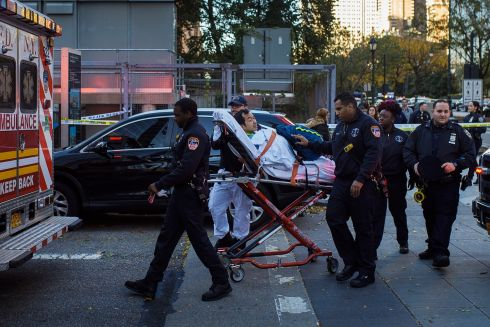 Emergency personnel carry a man into an ambulance after a motorist drove onto a busy bicycle path in New York. Photo: AP/Andres Kudacki