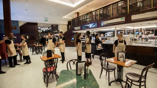 Staff uniforms have moved with the times at Bewley's Grafton Street, with a pouch to accommodate the tablets on which orders will be recorded. Photograph: Brenda Fitzsimons