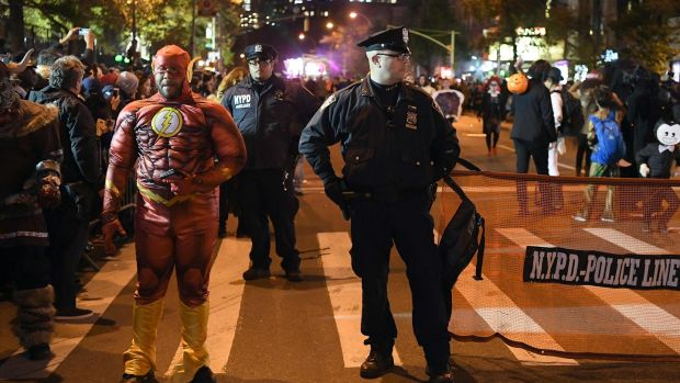 NYPD officers stand guard during the 44rd Annual Halloween Parade in New York. Photograph: Angela Weiss/AFP/Getty Images