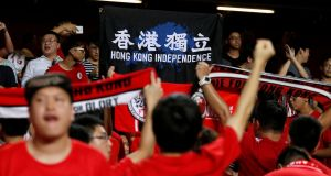 Hong Kong fans hold a protest banner and turn their backs during the Chinese national anthem during their Asian Cup qualifier against Malaysia  on October 10th. Photograph: Bobby Yip/Reuters