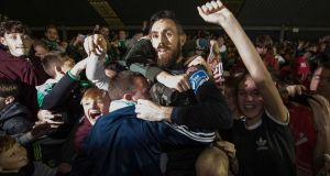Mark McNulty jumps into the crowd at the shed end to celebrate Cork City's league triumph. Photograph: Inpho