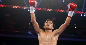 Jerwin Ancajas of the Philippines celebrates a knockout win against Fadhili Majiha of Tanzania during their bantamweight fight at The Venetian in Macau in 2015. Ancajas will fight Jamie Conlan in Belfast next month. Photo: Chris Hyde/Getty Images