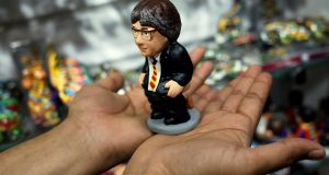 A mud figure of Carles Puigdemont, known as caganer (Catalan for defecator): More than 1,300 firms have moved their headquarters from Catalonia in the three weeks following its  illegal referendum for independence. Photograph: Jon Nazca/Reuters