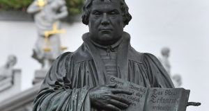 Martin Luther: October 31st was the 500th anniversary of the day Luther hammered his revolutionary theses on to a Wittenberg church door. Photograph: Hendrik Schmidt/AFP/Getty Images