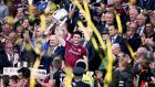 Galway's David Burke lifts the Liam MacCarthy Cup after they beat Waterford to win the All-Ireland. Photo: Tommy Dickson/Inpho