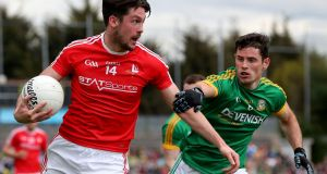 Louth's Eoin O'Connor holds off Donal Keogan of Meath during their Leinster championship encounter. Photograph: Bryan Keane/Inpho