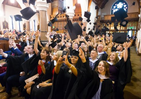 HATS OFF: Waterford Institute of Technology humanities graduates celebrate in Waterford city. Photograph: Patrick Browne