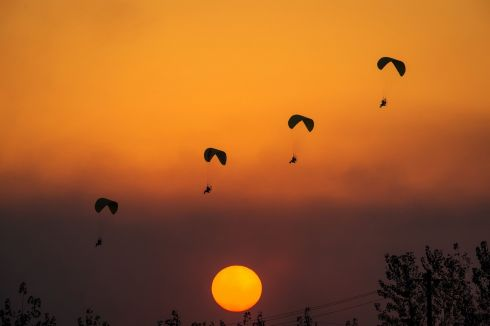 SKY SCRAPERS: Powered parachutists practise for the upcoming 2017 FAI World Fly-in Expo, in Wuhan, China. Photograph: STR/AFP/Getty Images