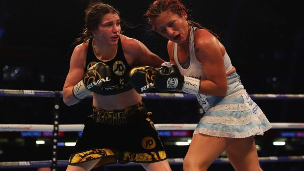 Taylor catches Anahi Sanchez with a left hook. Photo: Richard Heathcote/Getty Images