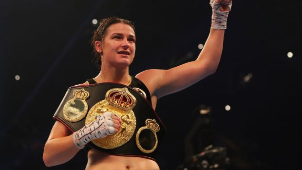 Katie Taylor celebrates with her belt after claiming the WBA lightweight title. Photo: Richard Heathcote/Getty Images