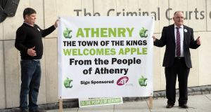 Athenry residents Martin Fergus and Kevin Higgins show their support for Apple's planned data centre in Athenry outside the Criminal Courts of Justice. Photograph: Collins Courts