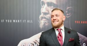 Irish mixed martial arts star Conor McGregor poses upon arrival to attend the world premiere of the documentary film Conor McGregor: Notorious at the Savoy Cinema in Dublin, Ireland.  Photograph: Paul Faith/AFP/Getty Images