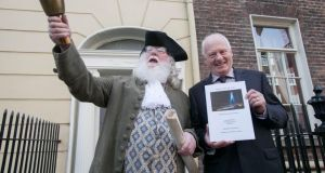 Drogheda City Status: town crier Sean Callan and Dr Brian Hughes with his report about the Louth town's future. Photograph: Gareth Chaney/Collins