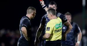 Referee Nigel Owens shows a red card to Andrew Conway of Munster during their Pro14 clash with Connacht. Photo: Billy Stickland/Inpho