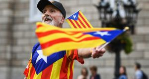 An independence supporter outside the Palau Catalan Regional Government Building in Barcelona earlier this week. Photograph: Jeff J Mitchell/Getty