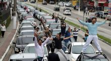 Uber drivers in Sao Paolo take a roof-top stand against legislation that they said would put them out of business. Photograph: Paulo Whitaker / Reuters